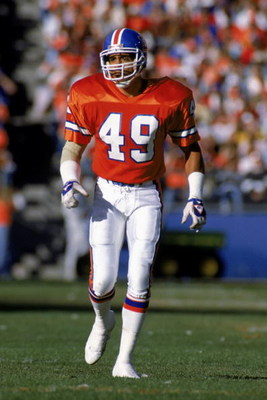 DENVER - NOVEMBER 5:  Dennis Smith #49 of the Denver Broncos walks on the field during a NFL game against the Pittsburgh Steelers at Mile High Stadium on November 5, 1989 in Denver, Colorado.  The Broncos defeated the Steelers 34-7.  (Photo by Tim DeFrisc