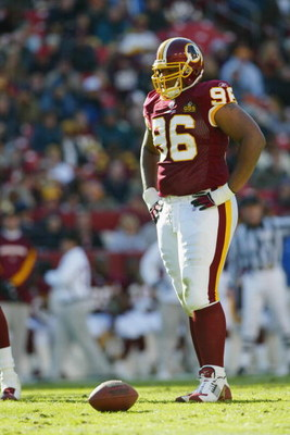 LANDOVER, MD - NOVEMBER 9:  Defensive tackle Darrell Russell #96 of the Washington Redskins on the field during the game against the Seattle Seahawks on November 9, 2003 at FedEx Field in Landover, Maryland. The Redskins defeated the Seahawks 27-20.  (Pho
