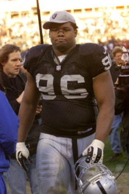 14 Jan 2001:  Darrell Russell #96 of the Oakland Raiders walks off the field after a 16-3 loss to the Baltimore Ravens after the AFC Championship game at Network Associates Coliseum in Oakland, California.  DIGITAL IMAGE. Mandatory Credit: Tom Hauck/ALLSP