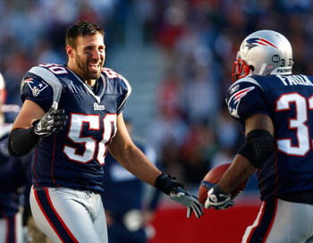 FOXBORO, MA - OCTOBER 26: Mike Vrabel #50 celebrates with teammate Kevin Faulk #33 of the New England Patriots, who caught a touchdown pass in the fourth quarter, against the St. Louis Rams at Gillette Stadium on October 26, 2008 in Foxboro, Massachusetts