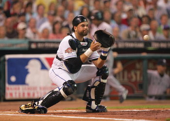 HOUSTON - JULY 13:  National League All-Star catcher Mike Piazza #31 of the New York Mets attempts to catch the ball during the Major League Baseball 75th All-Star Game against the American League All-Star Team at Minute Maid Park on July 13, 2004 in Hous