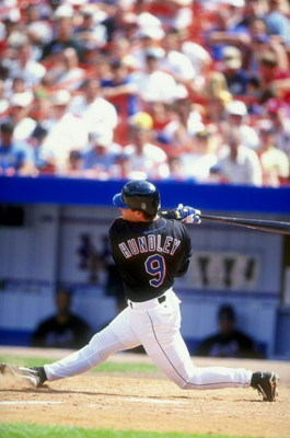 12 Jul 1998:  Todd Hundley #9 of the New York Mets at bat during the game against the Montreal Expos at the Shea Stadium in Flushing, New York. The Mets defeated the Expos 5-2.