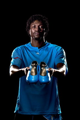 UNDATED - UNSPECIFIED:   In this handout image provided by adidas, Emmanuel Adebayor of Arsenal and Togo with his new adidas F50i football boots and training kit.  (Photo by Getty Images for adidas)