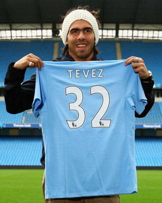 MANCHESTER, ENGLAND - JULY 14:  Carlos Tevez poses as he is unveilled at the City of Manchester Stadium after signing for Manchester City on July 14, 2009 in Manchester, England.  (Photo by Matthew Lewis/Getty Images)