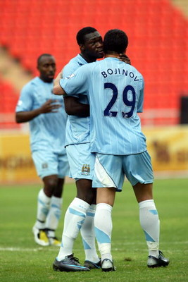 BANGKOK, THAILAND - MAY 17:  Caicedo of Manchester City is congratulated by Bojinov after scoring against All Star Thailand XI during the Friendly Match between Manchester City and All Star Thailand XI at the Rajamangala Stadium on May 17, 2008 in Bangkok