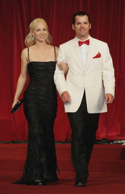 KILDARE, IRELAND - SEPTEMBER 20:  Paul Casey and Jocelyn Hefner walk down the catwalk during the Ryder Cup Gala Dinner at Citywest Hotel and Golf Resort September 20, 2006 in Dublin, Ireland.  (Photo by David Cannon/Getty Images)