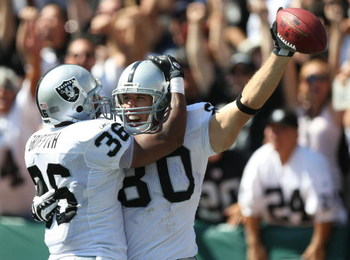 OAKLAND, CA - SEPTEMBER 28:   Zach Miller #80 of the Oakland Raiders celebrates with Justin Griffith #36 after scoring a touchdown against the San Diego Chargers during an NFL game on September 28, 2008 at McAfee Coliseum in Oakland, California.  (Photo b