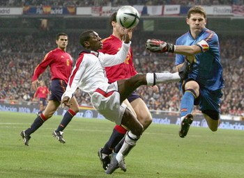 MADRID, SPAIN - NOVEMBER 17: Shaun Wright Phillips of England battles for the ball with Casillas of Spain during the international friendly match between Spain and England on November 17, 2004 at the Estadio Bernabeu in Madrid, Spain. (Photo by Ben Radfor