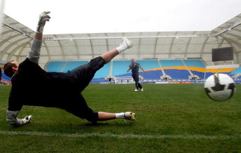 GOLD COAST, AUSTRALIA - JULY 07:  Archie Thompson of the Melbourne Victory attempts to get the ball past goalkeeper Mark Schwarzer of Fulham FC after a Fulham training session at Skilled Stadium on July 7, 2009 in Gold Coast, Australia. (Photo by Bradley