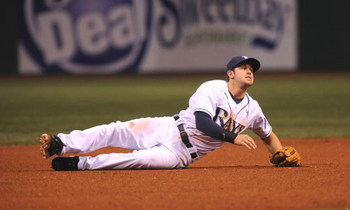 ST. PETERSBURG, FL - APRIL 14:  Evan Longoria #3 of the Tampa Bay Rays falls to the dirt after diving for a ball against the New York Yankees April 14, 2009 in St. Petersburg, Florida.  (Photo by Al Messerschmidt/Getty Images)