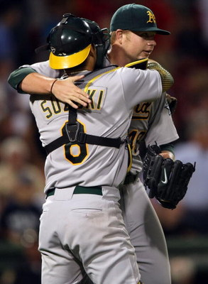 BOSTON - JULY 06:  Starting pitcher Brett Anderson #49 of the Oakland Athletics is congratulated by Kurt Suzuki #8 after his shutout against the Boston Red Sox on July 6, 2009 at Fenway Park in Boston, Massachusetts. The Athletics defeated the Red Sox 6-0