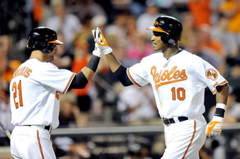 BALTIMORE - MAY 09:  Adam Jones #10 of the Baltimore Orioles is congratulated by Nick Markakis #21 after hitting a home run in the eighth inning against the New York Yankees at Oriole Park at Camden Yards on May 9, 2009 in Baltimore, Maryland.  (Photo by