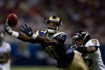 ST. LOUIS, MO - AUGUST 23: Donnie Avery #17 of the St. Louis Rams attempts to make a catch against Corey Ivy #35 of the Baltimore Ravens at the Edward Jones Dome August 23, 2008 in St. Louis, Missouri. (Photo by Dilip Vishwanat/Getty Images)