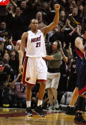 MIAMI - APRIL 25:  Jamaal Magloire #21 of the Miami Heat celebrates after the Heat take a 21 point lead at half-time against the Atlanta Hawks during Game Three of the Eastern Conference Quarterfinals at American Airlines Arena on April 25, 2009 in Miami,