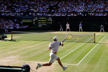 WIMBLEDON, ENGLAND - JULY 03:  A general view of Centre Court as Andy Roddick of USA plays a forehand during the men's singles semi final match against Andy Murray of Great Britain on Day Eleven of the Wimbledon Lawn Tennis Championships at the All Englan