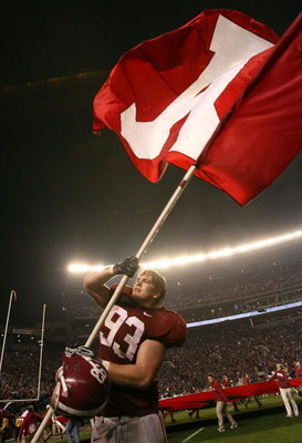 TUSCALOOSA, AL - NOVEMBER 29:  Defensive lineman Bobby Greenwood #93 of the Alabama Crimson Tide waves an Alabama flag after defeating the Auburn Tigers at Bryant-Denny Stadium on November 29, 2008 in Tuscaloosa, Alabama. Alabama defeated Auburn 36-0.  (P