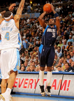 DENVER - MAY 05:  Jason Terry #31 of the Dallas Mavericks takes a shot against Kenyon Martin #4 of the Denver Nuggets in Game Two of the Western Conference Semifinals during the 2009 NBA Playoffs at Pepsi Center on May 5, 2009 in Denver, Colorado. The Nug