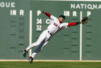 BOSTON - OCTOBER 5:  Shortstop Nomar Garciaparra #5 of the Boston Red Sox dives for a ball hit by Jose Guillen of the Oakland Athletics in game four of the American League Division Series on October 5, 2003 at Fenway Park in Boston, Massachusetts. Garciap