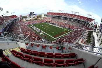 TAMPA, FL - DECEMBER 6: A small crowd watches as the Boston College Eagles battle the Virginia Tech Hokies  in the 2008 ACC Football Championship game at Raymond James Stadium on December 6, 2008 in Tampa, Florida.  (Photo by Al Messerschmidt/Getty Images