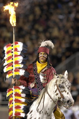 TALLAHASSEE, FL - OCTOBER 27: The mascot of the Florida State Seminoles carries a ligthted spear before play against the Duke Blue Devils at Doak Campbell Stadium on October 27, 2007 in Tallahassee, Florida.  FSU won 25-6. (Photo by Al Messerschmidt/Getty