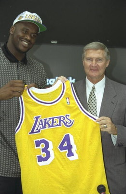 18 Jul 1996:  Center Shaquille O''Neal (left) poses with Los Angeles Lakers General Manager Jerry West and his new Lakers jersey during a press conference at the Media Press Center in Atlanta, Georgia.  Mandatory Credit: Jed Jacobson/Allsport