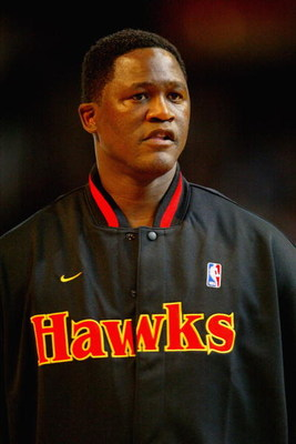 ATLANTA - FEBRUARY 8:  Dominique Wilkins of the Atlanta Team looks on before the Jeep Hoop it Up Game during the 2003 NBA All Star weekend at Philips Arena on February 8, 2003 in Atlanta, Georgia.  NOTE TO USER: User expressly acknowledges and agrees that