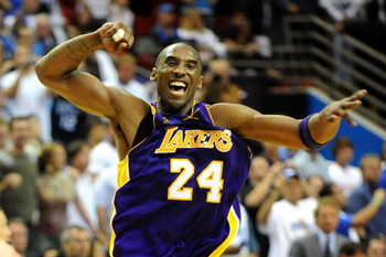 ORLANDO, FL - JUNE 14:  Kobe Bryant #24 of the Los Angeles Lakers celebrates after defeating the Orlando Magic 99-86 in Game Five of the 2009 NBA Finals on June 14, 2009 at Amway Arena in Orlando, Florida.  NOTE TO USER:  User expressly acknowledges and a