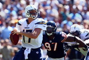 SAN DIEGO - SEPTEMBER 9:  Starting Quarterback Philip Rivers #17 of the San Diego Chargers is sacked by Mark Anderson #97 and Darwin Walker #99 of the Chicago Bears at Qualcomm Stadium September 9, 2007 in San Diego, California.  (Photo by Donald Miralle/