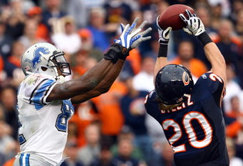 CHICAGO - NOVEMBER 02:  Craig Steltz #20 of the Chicago Bears intercepts a pass intended for Calvin Johnson #81 of the Detroit Lions during the fourth quarter at Soldier Field on November 2, 2008 in Chicago, Illinois. The Bears defeated the Lions 27-23.