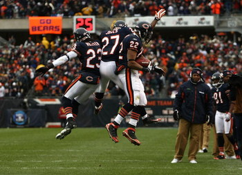 CHICAGO - NOVEMBER 09:  (L-R) Devin Hester #23, Kevin Jones #27 and Matt Forte #22 of the Chicago Bears celebrate after Forte scored a on 5-yard touchdown reception in the first quarter against the Tennessee Titans at Soldier Field on November 9, 2008 in