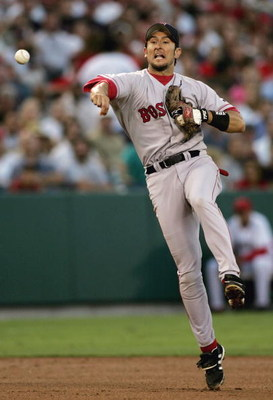 ANAHEIM, CA - JULY 15:  Shortstop Nomar Garciaparra #5 of the Boston Red Sox throws to first to record the force out on David Eckstein #22 of the Anaheim Angels on July 15, 2004 at the Angel Stadium of Anaheim in Anaheim, California.  (Photo by Doug Benc/
