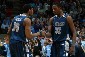 EAST RUTHERFORD, NJ - MARCH 25:  Patrick Ewing Jr. #33 and Jeff Green #32 of the Georgetown Hoyas slaps hands during a timeout against the University of North Carolina Tar Heels in the NCAA Men's East Regional Final at the Continental Airlines Arena in th