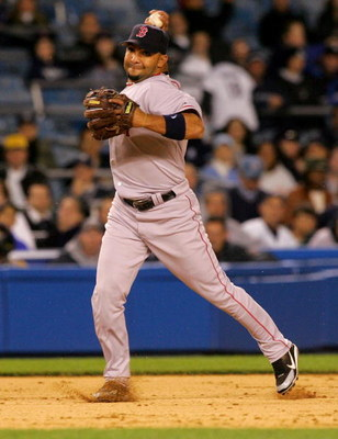 NEW YORK - MAY 09:  Alex Gonzalez #11 of the Boston Red Sox fields a ball against the New York Yankees on May 9, 2006 at Yankee Stadium in the Bronx borough of New York City.  (Photo by Jim McIsaac/Getty Images)