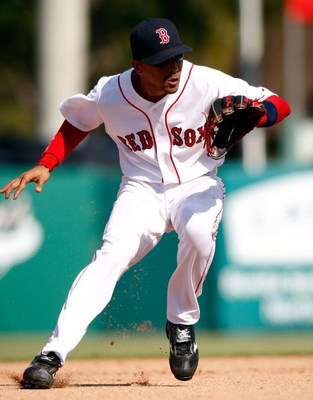 FORT MYERS, FL - MARCH 02:  Shortstop Julio Lugo #23 of the Boston Red Sox makes a play on the ball against the Minnesota Twins during the game on March 2, 2008 at City of Palms Park in Ft. Myers, Florida.  (Photo by J. Meric/Getty Images)