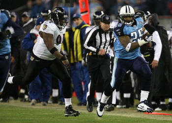 NASHVILLE, TN - JANUARY 10:  Running back LenDale White #25 of the Tennessee Titans runs the ball down the sideline by Marques Douglas #91 of the Baltimore Ravens in the third quarter during the AFC Divisional Playoff Game on January 10, 2009 at LP Field