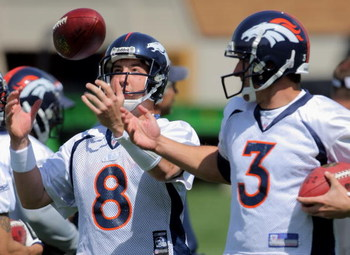 ENGLEWOOD, CO - MAY 03:  Quarterback Kyle Orton #8 has the ball jokingly tipped form his hands by  sixth round draft pick rookie quarterback Tom Brandslater #3 during Denver Broncos Minicamp at the Broncos training facility on May 3, 2009 in Englewood, Co