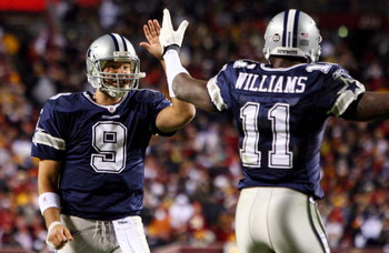 LANDOVER, MD - NOVEMBER 16:  Tony Romo #9 of the Dallas Cowboys celebrates his teams first touchdown against the Washington Redskins with teammate Roy Williams #11 on November 16, 2008 at FedEx Field in Landover, Maryland.  (Photo by Jim McIsaac/Getty Ima