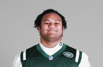 EAST RUTHERFORD, NJ - 2005:  Sione Pouha of the New York Jets poses for his 2005 NFL headshot at photo day in East Rutherford, New Jersey.  (Photo by Getty Images)