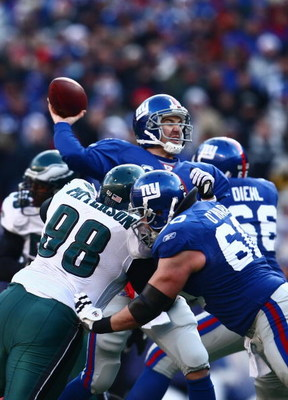 EAST RUTHERFORD, NJ -  JANUARY 11:  Eli Manning #10 of the New York Giants throws a pass against the Philadelphia Eagles during the NFC Divisional Playoff Game on January 11, 2009 at Giants Stadium in East Rutherford, New Jersey.  The Eagles defeated the