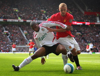 MANCHESTER, UNITED KINGDOM - MARCH 23:  Wes Brown of Manchester United battles for the ball with Ryan Babel of Liverpool during the Barclays Premier League match between Manchester United and Liverpool at Old Trafford on March 23, 2008 in Manchester, Engl