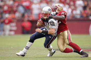SAN FRANCISCO - OCTOBER 5:  Quarterback Matt Cassel #16 of the New England Patriots is sacked by Patrick Willis #52 of the San Francisco 49ers during an NFL game on October 5, 2008 at Monster Park in San Francisco, California.