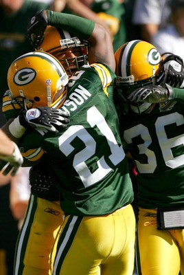GREEN BAY, WI - SEPTEMBER 23:  Nick Barnett #56 of the Green Bay Packers is congratulated by teammates Charles Woodson #21 and Nick Collins #36 after catching an interception late in the fourth quarter against the San Diego Chargers at Lambeau Field Septe