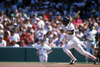 BOSTON - JULY:  Jim Rice #14 of the Boston Red Sox bats during a July 1985 game at Fenway Park in Boston, Massachusetts. (Photo by Rick Stewart/Getty Images)