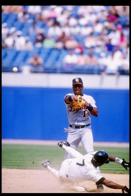 4 Jun 1995:  Second baseman Lou Whitaker of the Detroit Tigers (standing) throws the ball during a game against the Chicago White Sox at Comiskey Park in Chicago, Illinois.  The Tigers won the game, 8-5. Mandatory Credit: Jonathan Daniel  /Allsport