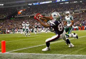 FOXBORO, MA - NOVEMBER 13: Randy Moss #81 of the New England Patriots catches a touchdown pass against the defense of Ty Law #22 and Kerry Rhodes #25 of the New York Jets at Gillette Stadium on November 13, 2008 in Foxboro, Massachusetts. The Jets won 34-