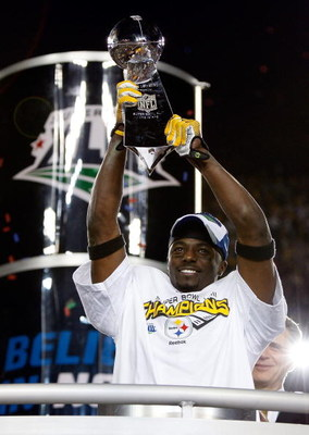 TAMPA, FL - FEBRUARY 01:  Super Bowl MVP Santonio Holmes #10 of the Pittsburgh Steelers celebrates with the Vince Lombardi trophy after their 27-23 win against the Arizona Cardinals during Super Bowl XLIII on February 1, 2009 at Raymond James Stadium in T
