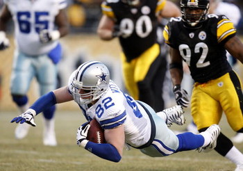 PITTSBURGH - DECEMBER 07: Jason Witten #82 of the Dallas Cowboys dives for a first quarter first down in front of James Harrison #92 of the Pittsburgh Steelers on December 7, 2008 at Heinz Field in Pittsburgh, Pennsylvania.  (Photo by Gregory Shamus/Getty