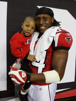 ATLANTA - DECEMBER 28:  Wide receiver Roddy White #84 of the Atlanta Falcons celebrates on the sidelines after defeating the St. Louis Rams at Georgia Dome on December 28, 2008 in Atlanta, Georgia.  The Falcons defeated the Rams 31-27.  (Photo by Doug Ben