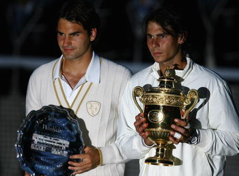 LONDON - JULY 06:  Rafael Nadal of Spain and Roger Federer of Switzerland pose for pictures with after Nadal won in five sets in the final on day thirteen of the Wimbledon Lawn Tennis Championships at the All England Lawn Tennis and Croquet Club on July 6