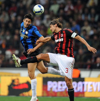 MILAN, ITALY - SEPTEMBER 28:  Julio Cruz of Inter Milan competes for the ball in the air with Paolo Maldini (R) of AC Milan during the Serie A match between AC Milan and Inter Milan at the Stadio Giuseppe Meazza on September 28, 2008 in Milan, Italy.  (Ph